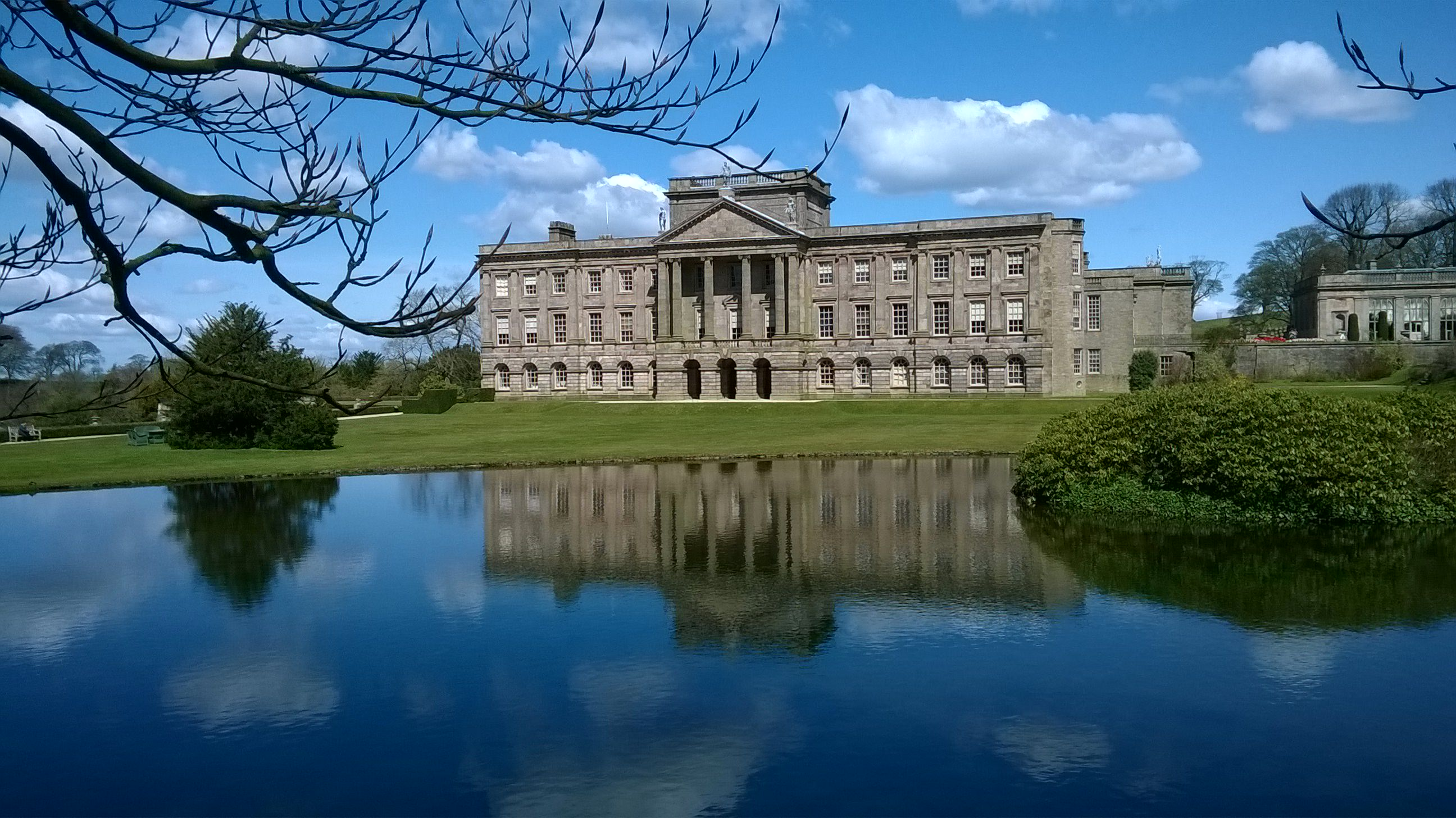 Photo of Lyme Hall from over the reflection lake